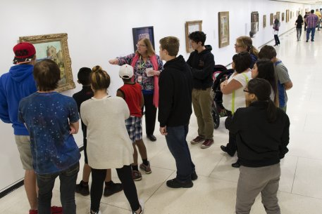 An AK docent leads a public tour