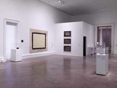 Installation view of Roast Kalvar, 1974, Yellow Movie 12/14–15/72, 1972, Yellow TV, 1973, Yellow TV, 1973, and Yellow TV, 1973, in Introducing Tony Conrad: A Retrospective (Albright-Knox Art Gallery, March 3–May 27, 2018)