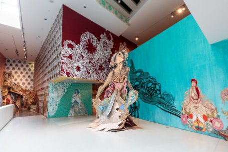 An installation view of Swoon's artworks on wall and in sculpture
