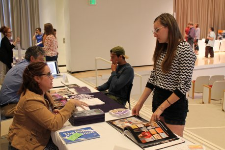 Teens talk to college representatives at the 2015 AK Teens College Art Career Day