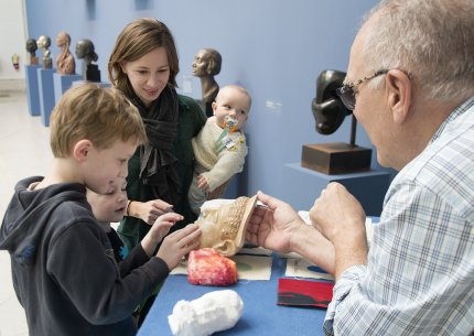 A family interacts with materials on the Albright-Knox's ArtCart