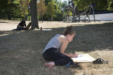 Teens drawing outside on the AK campus