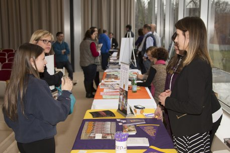 Teens talk to college representatives at the 2017 AK Teens College Art Career Day