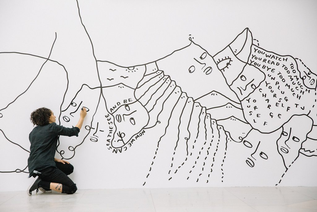 Shantell Martin working on a mural in the Albright-Knox's Sculpture Court.