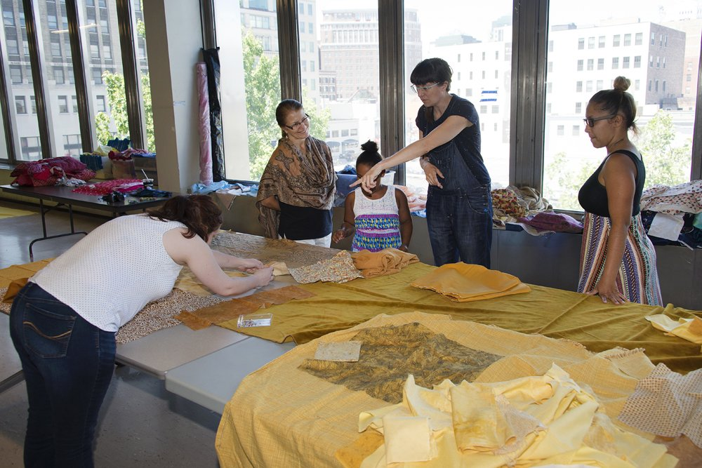 Amanda Browder and volunteers sew fabric for Spectral Locus at the Buffalo and Erie County Public Library's Central Library