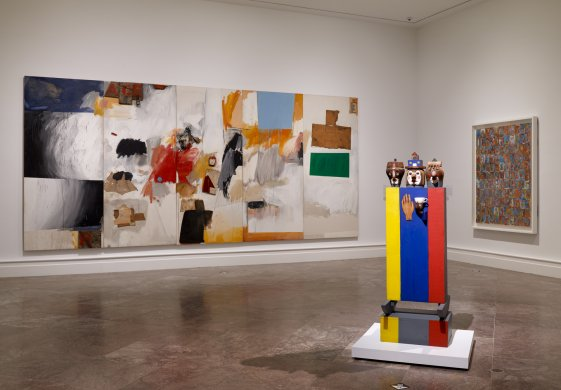From left: Robert Rauschenberg's Ace, 1962, Marisol's Tea for Three, 1960; and Jasper Johns's Numbers in Color, 1958–59, on view in Giant Steps: Artists and the 1960s