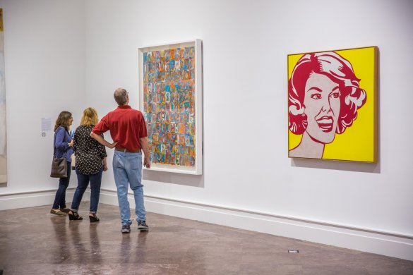 Visitors with Jasper Johns's Numbers in Color, 1958–59, and Roy Lichtenstein's Head—Red and Yellow, 1962, in Giant Steps: Artists and the 1960s