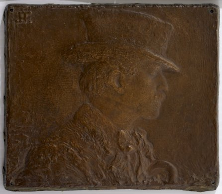 Profile Bust of a Man in a Hat Facing RIght