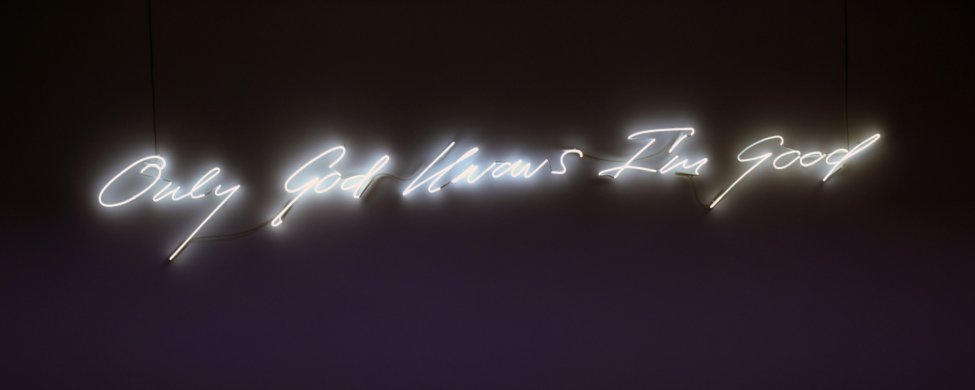 "The phrase ""Only God Knows I'm Good"" in cursive English script is fabricated in snow white neon, which is mounted on a wall."
