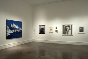Installation view of WALL ROCKETS: Contemporary Artists and Ed Ruscha with Ruscha's WALL ROCKETS, 2000, on the left
