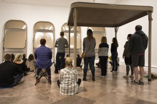 Guests meditate under and around Robert Therrien's No title (folding table and chairs, beige), 2006
