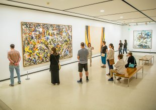 People on a tour in the Lower Level East gallery featuring Abstract Expressionist works