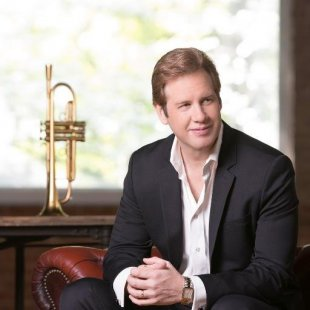 Joe Gransden sitting with his trumpet next to him