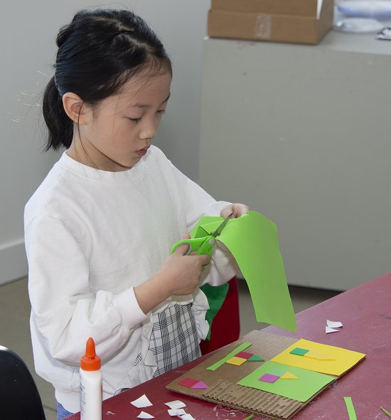 A girl cutting paper