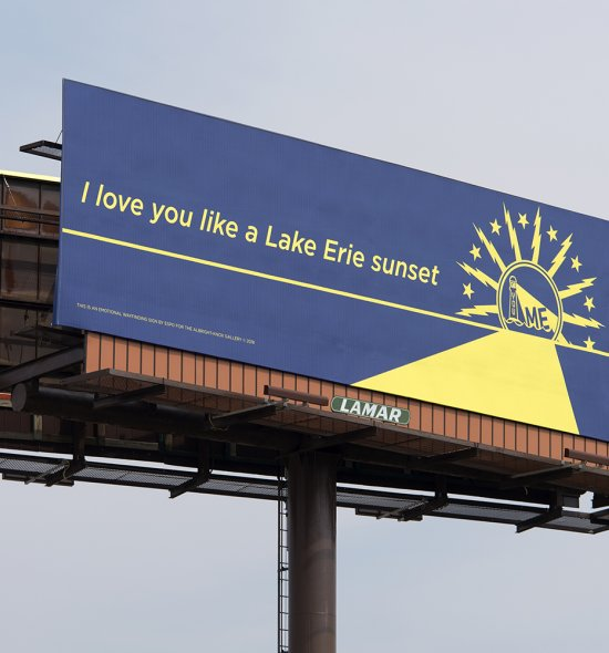 """A large blue billboard with yellow letters that say """"I love you like a Lake Erie sunset"""""""