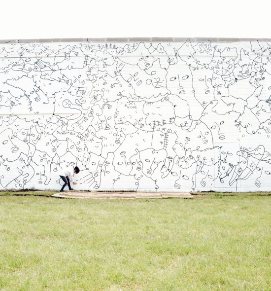 Shantell Martin working on her mural,Dance Everyday, 2017, at 537 East Delavan Avenue