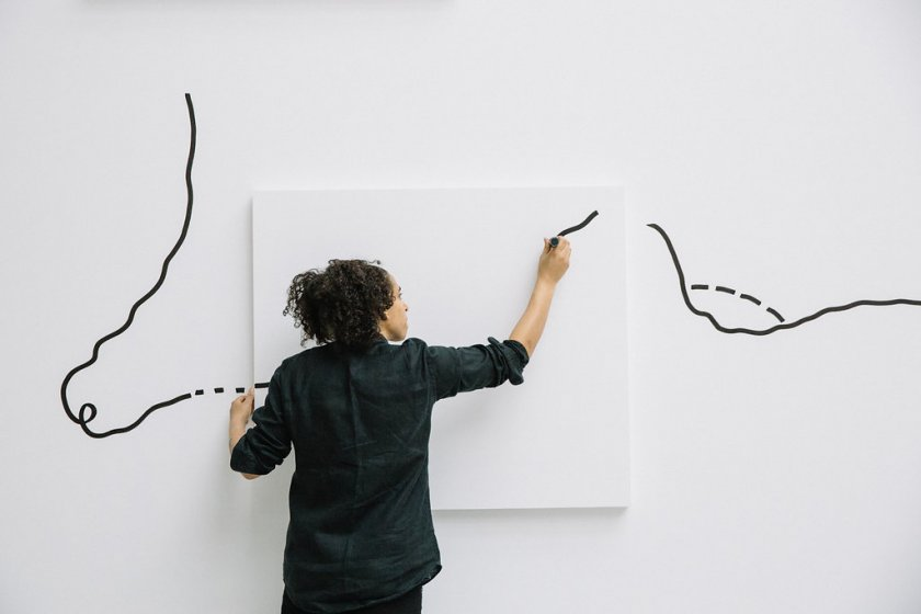 Shantell Martin beginning a mural in the Albright-Knox's Sculpture Court.