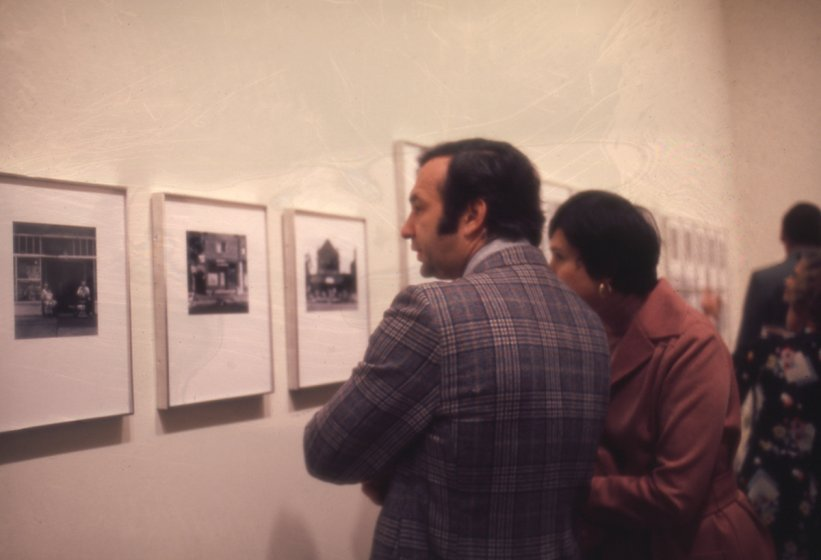 Visitors at the Members' opening of Lower West Side, Buffalo, New York: Photographs by Milton Rogovin on September 26, 1975.